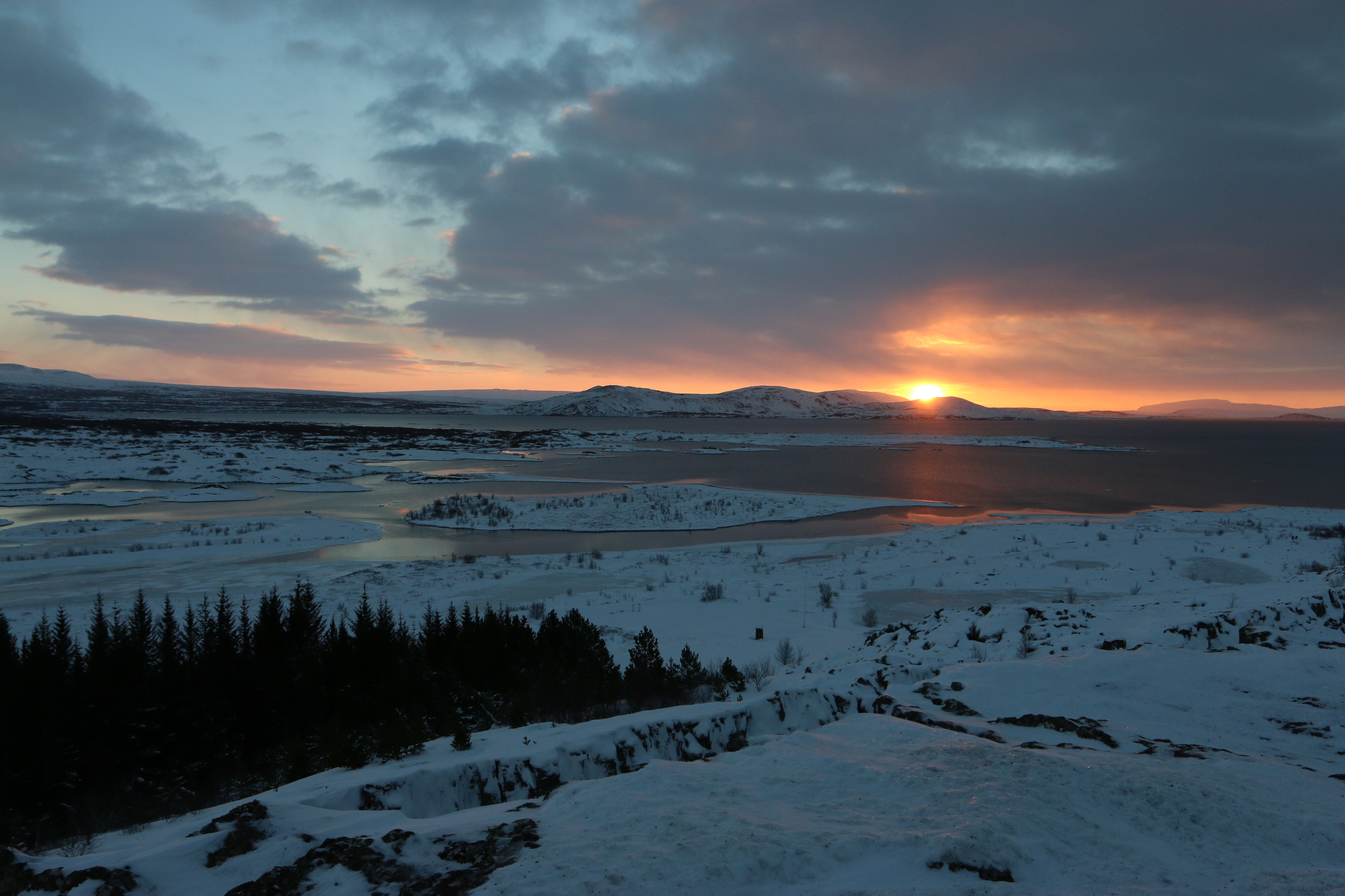 Like a moody teenager, the sun rises at noon over þingvellir National Park in Iceland, December 2014.
